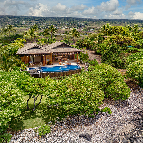 Hawaiian living at its best! Designed & built uniquely with extensive custom woodwork featuring Ohia for siding, decking, trellises, and posts.  View Listing    →