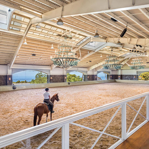 Equestrian estate with 3 separate parcels totaling 34.89 acres being sold together. 17000 +/- barn with professional indoor arena with three chandeliers over center ring, 13 stalls with mats, center hall is paved with imported cobble stones.  View Listing    →