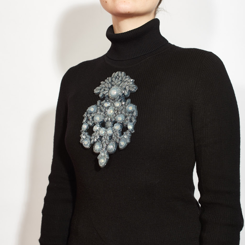 """Her giant magnetic silicone brooches are a tribute to the """"stomacher"""". She is exhorting us to let them get out of the vaults and be worn again! -"""