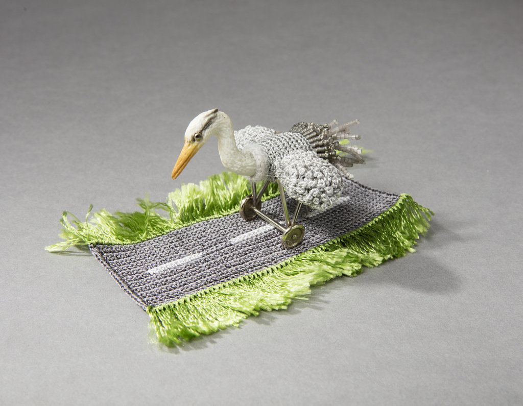 Grey Heron Airplane Ring Object with Ring - Designed by Felieke van der Leest, 2006.Textile (viscose,polyester/polyamide), plastic heron, 14kt gold, glass beads, marcasite.