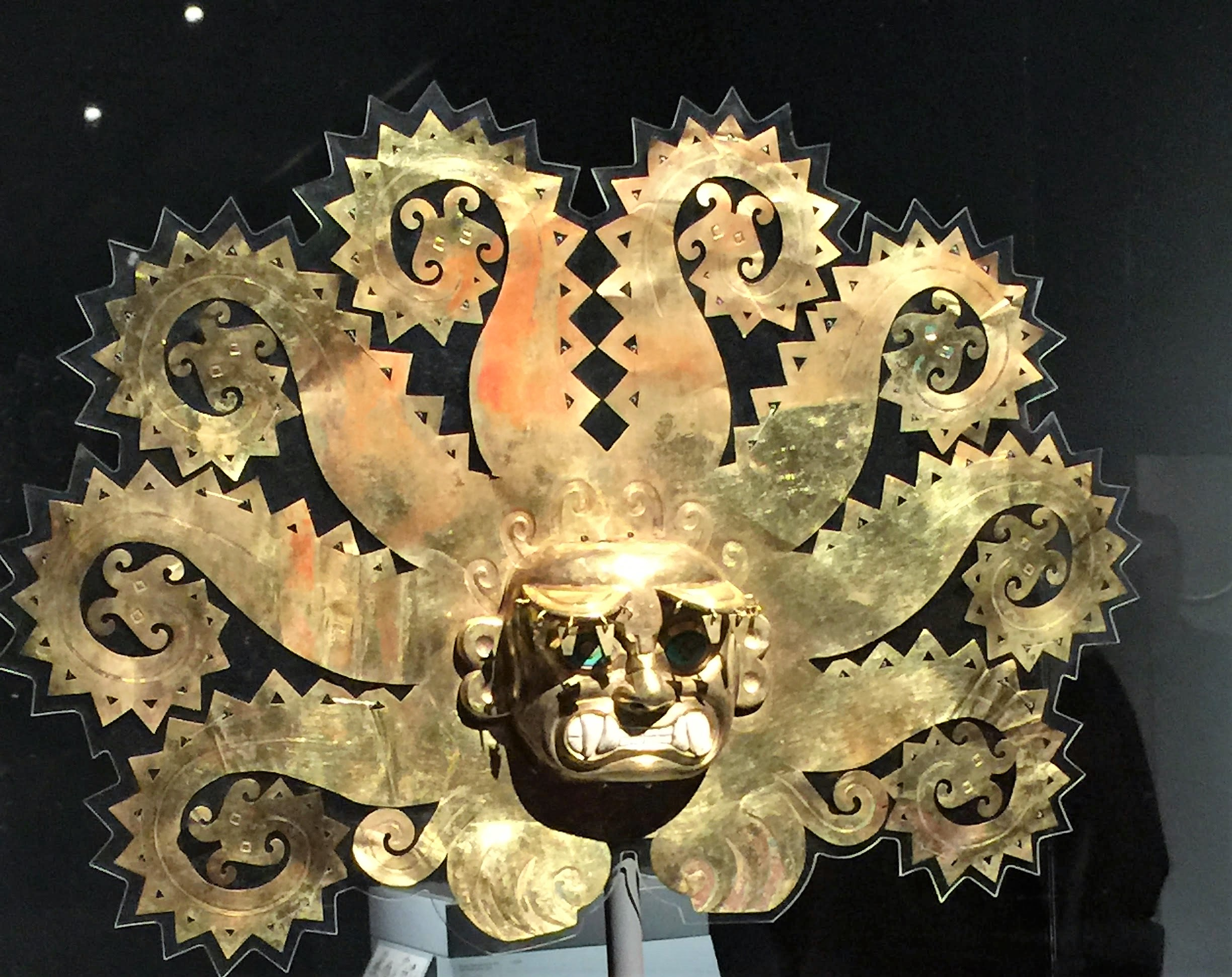 Octopus Frontlet - This object would have been affixed to a cylindrical headdress. Made of gold sheet, it was cut into the shape of a supernatural figure with serrated octopus tentacles that terminate in catfish heads.