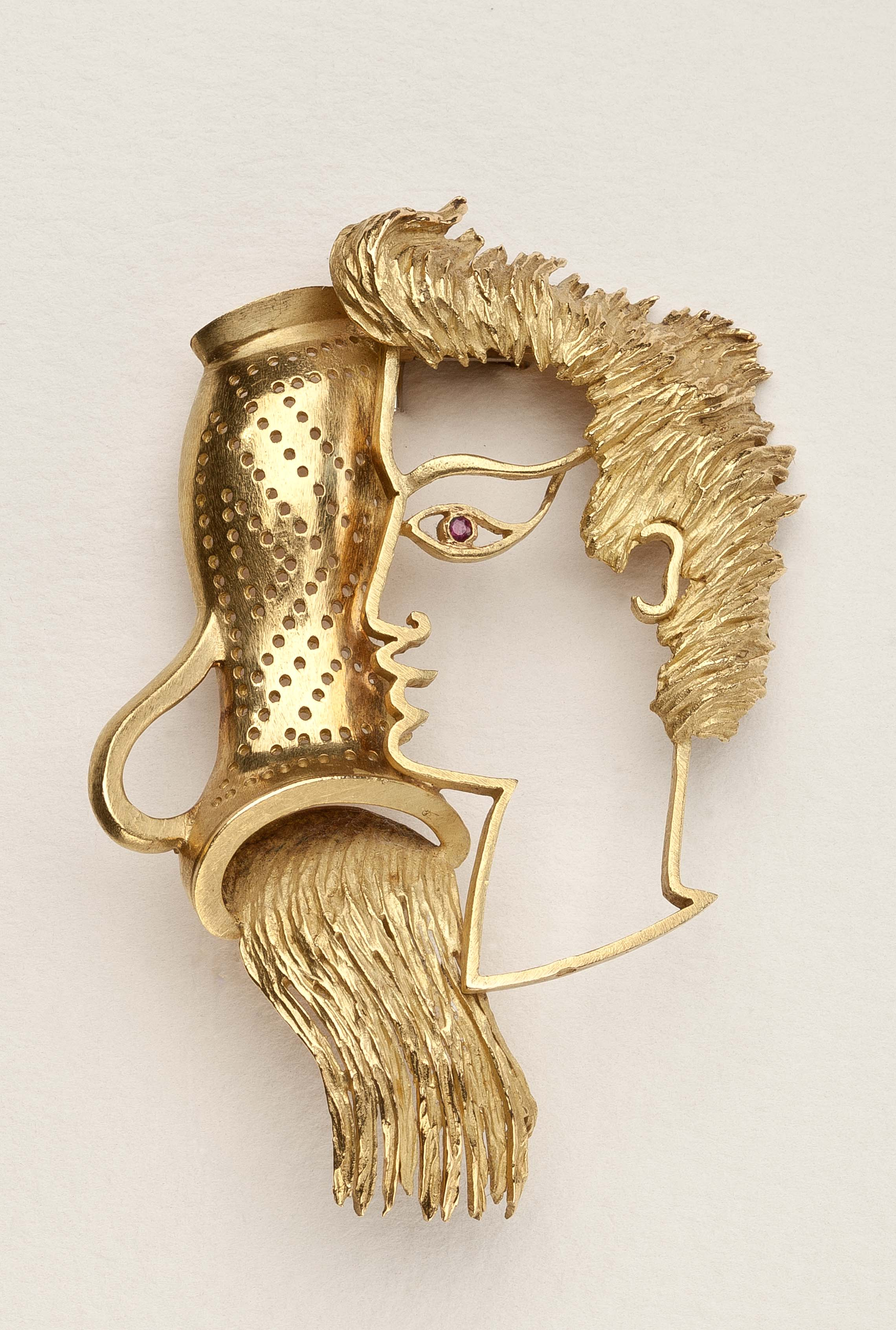 jean cocteau gold brooch.jpg