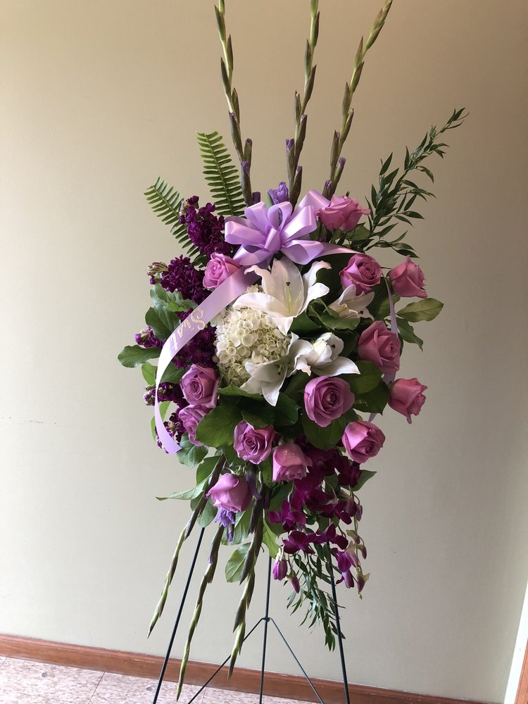 Easel Spray - $ 300.00Purple Rose, Purple Stock, Purple Orchid, Lavender Glads, White Oriental Lily, Italian Ruskus.