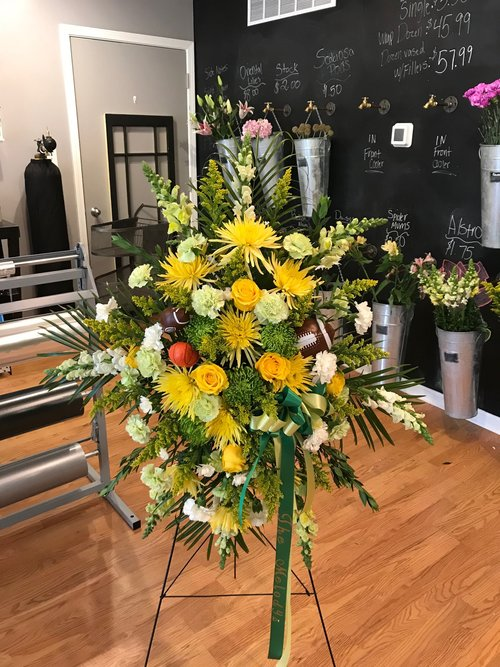 easel Sprays - $ 275.00Green and Yellow Spider Mum, Yellow Snaps, Yellow Rose, White and Green Carnation, Solidago, Myrtle.