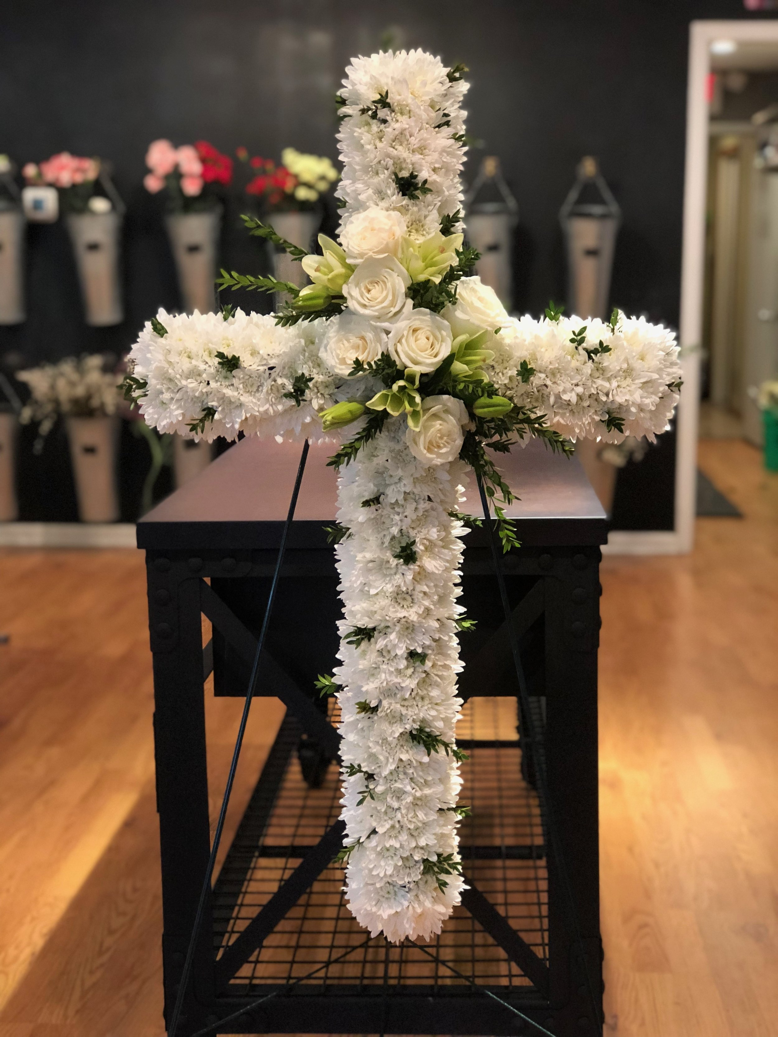 Easel Cross - $300.00White Poms, White Rose, White Asiatic Lily, Myrtle.