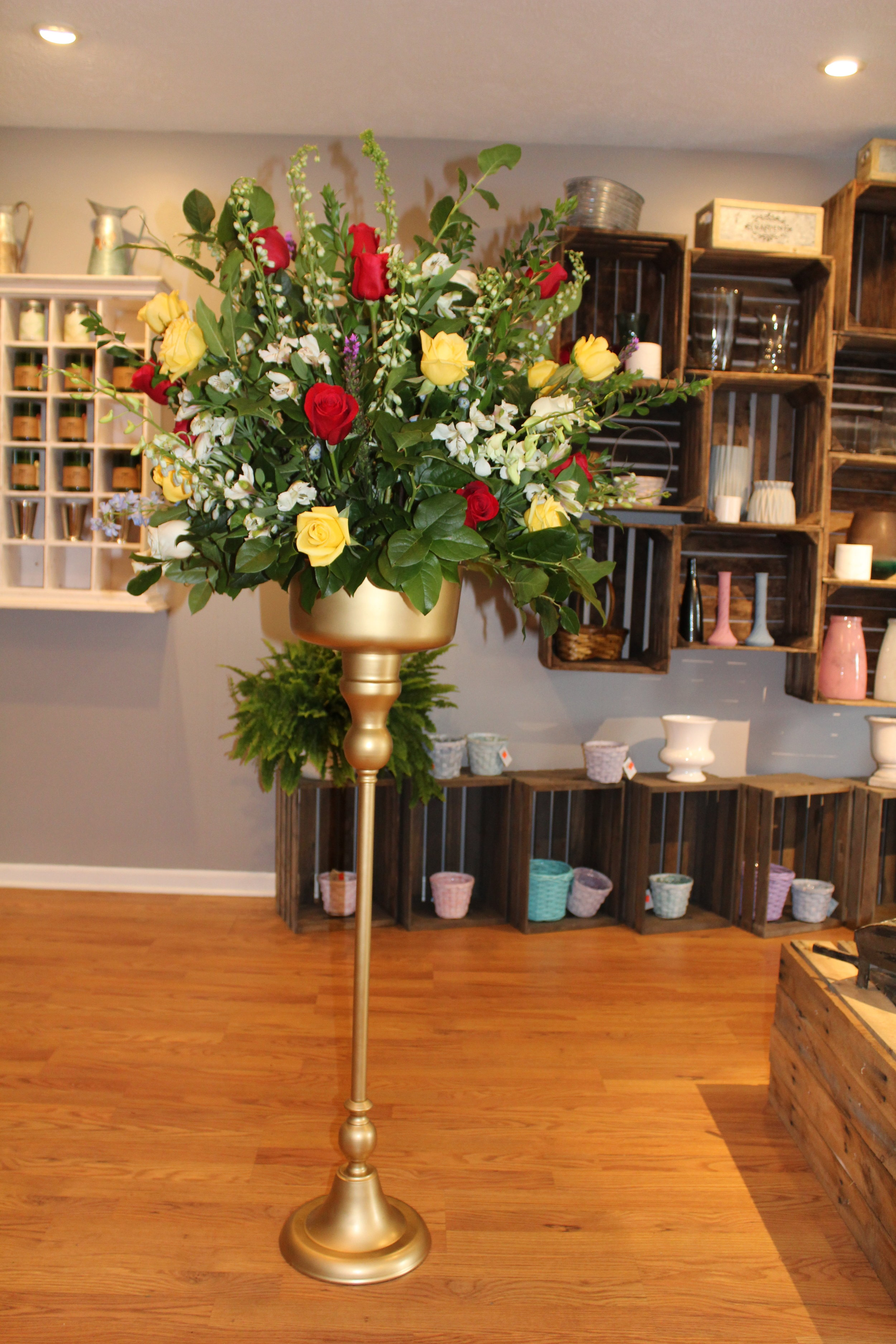 Urn Spray - $ 225.00Yellow and Red Rose, White Orchid, Blue Delphinium, Purple Liatris, Lemon Leaf, White Alstromeria.