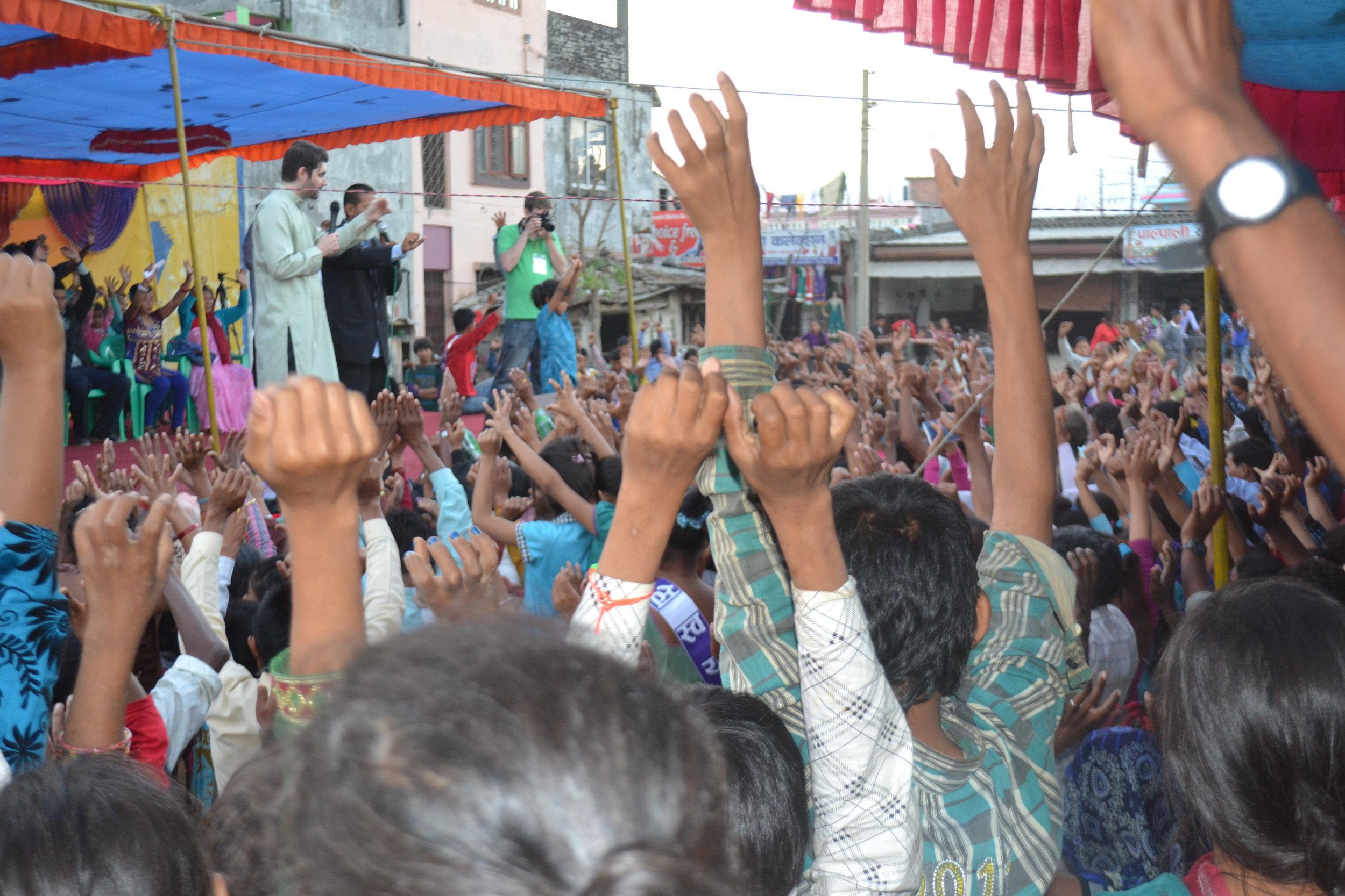 charles-w-crowd-raising-hands.jpg