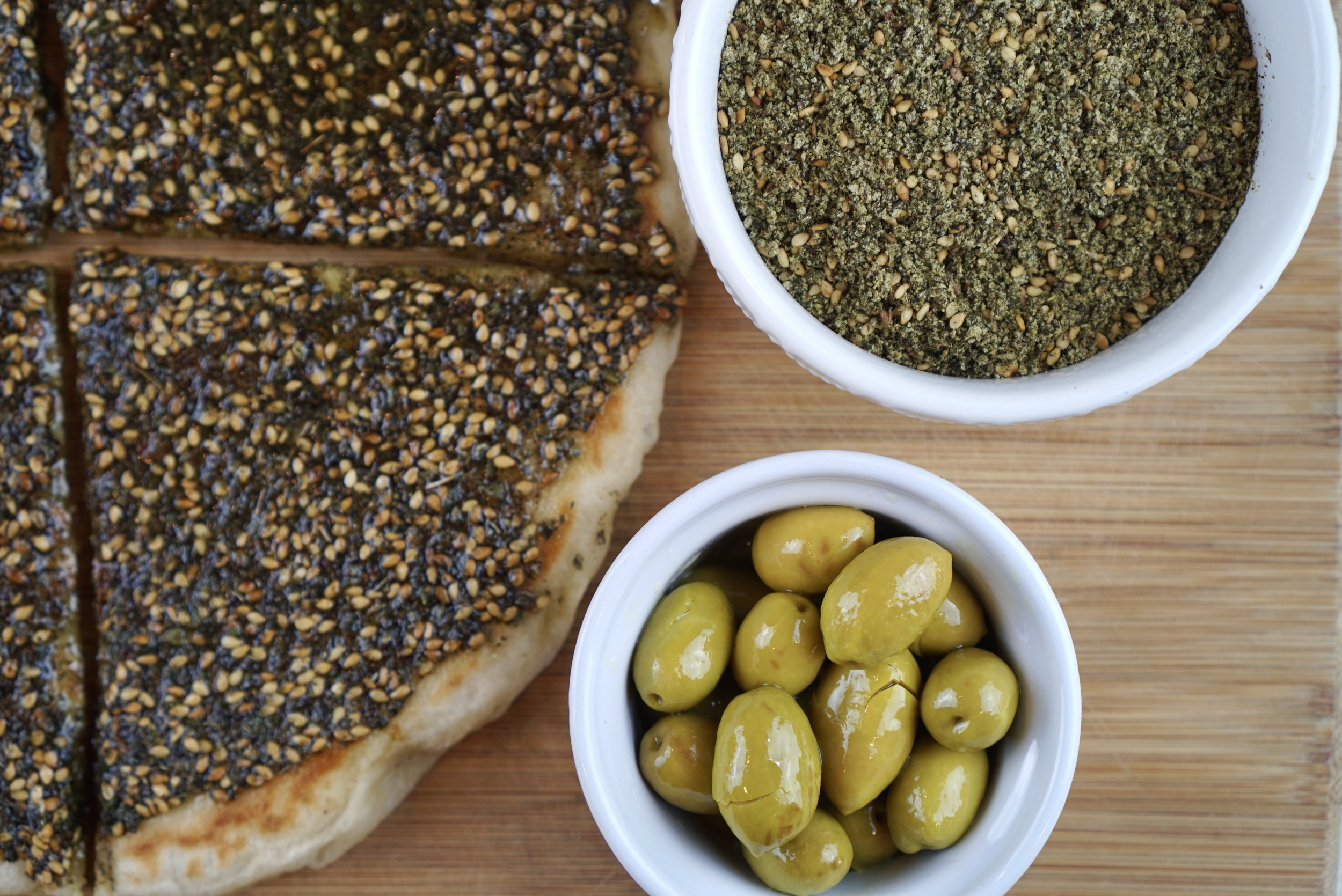 Mana'eesh: Middle Eastern flatbreads topped with za'atar mixed with olive oil and fresh local farm veggies
