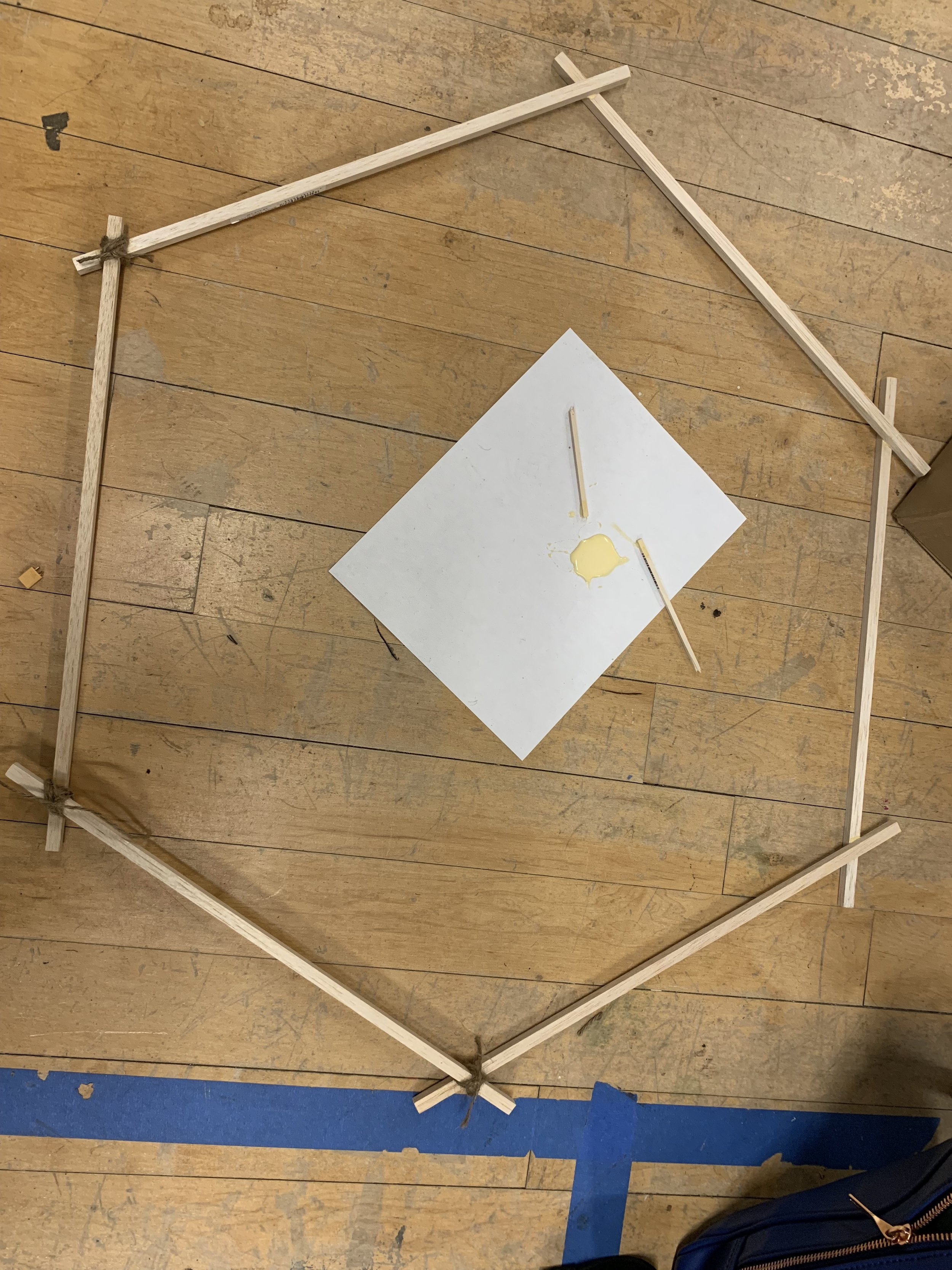 wood hexagon structure with wood glue and twine