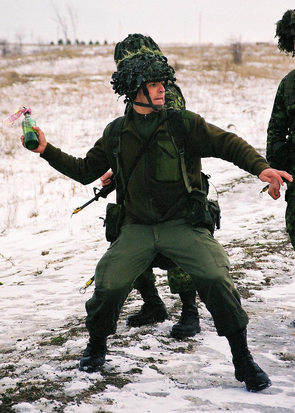 Canadian soldier throwing a Molotov cocktail