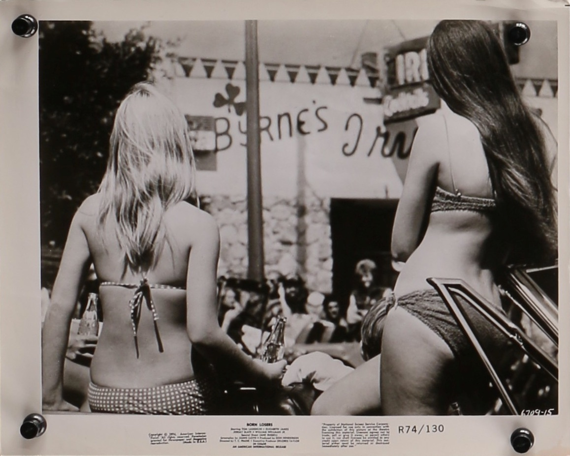 Whatever the outlaw biker picture, whether in bikinis or not, small town girls are always a willing audience for the hoodlums' pranks