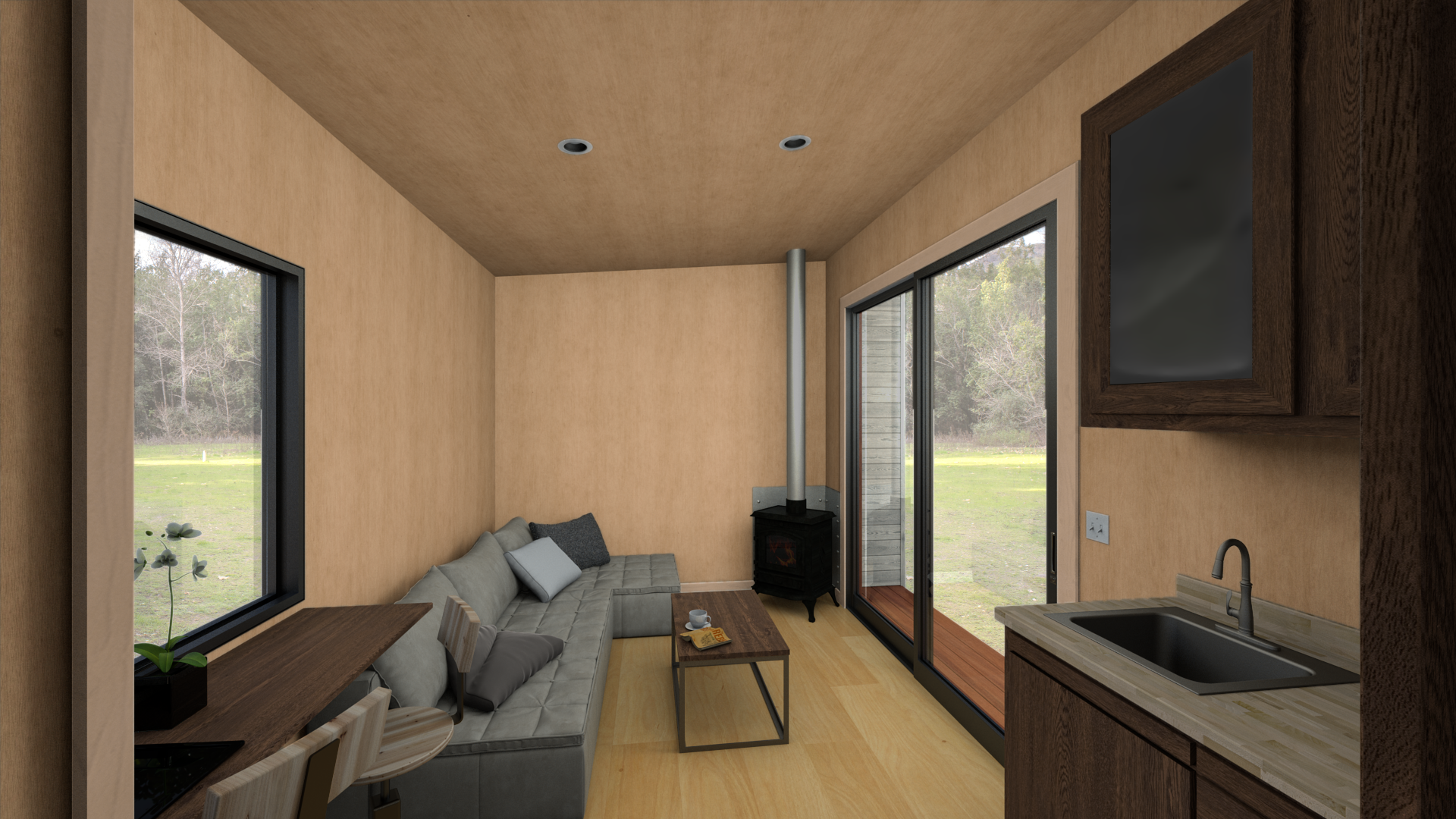 The interior is a blank canvas, shown here configured as a guest suite with the optional wood stove and kitchenette.