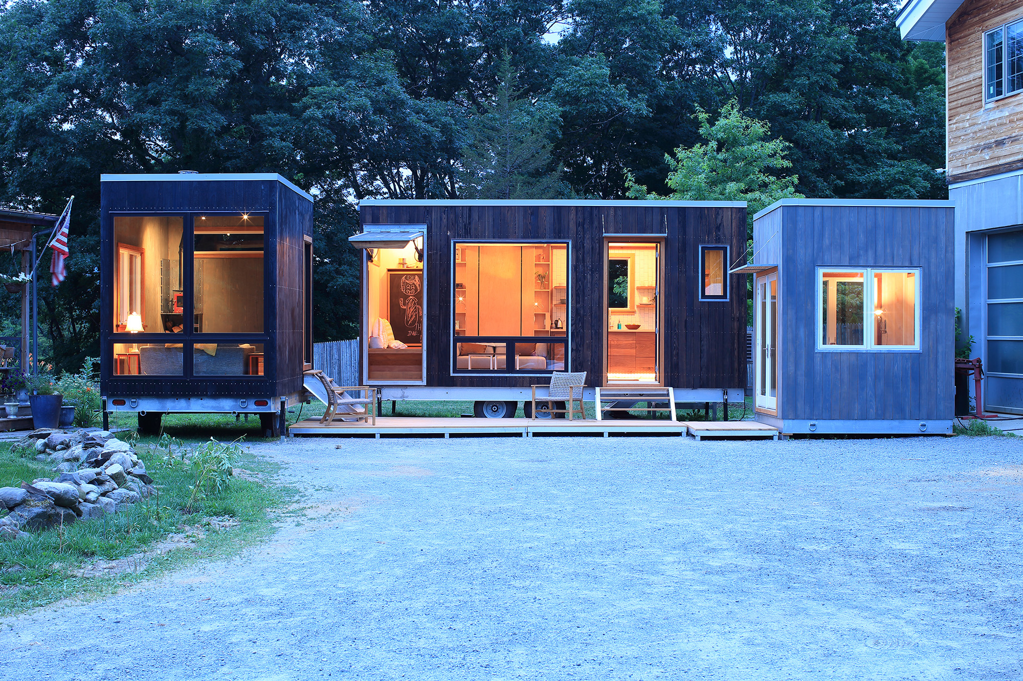All three available units set up as a compound (L to R): Living room/guest room, Main House with bath/kitchen/bed, and office. Connected by custom decking units. Available for sale individually, but don't they look great all together?