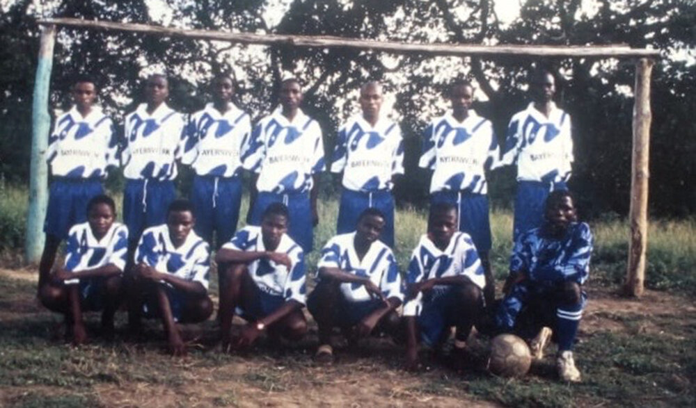 Before the incident, Arnold with his football team. He is on the standing row, second from the left
