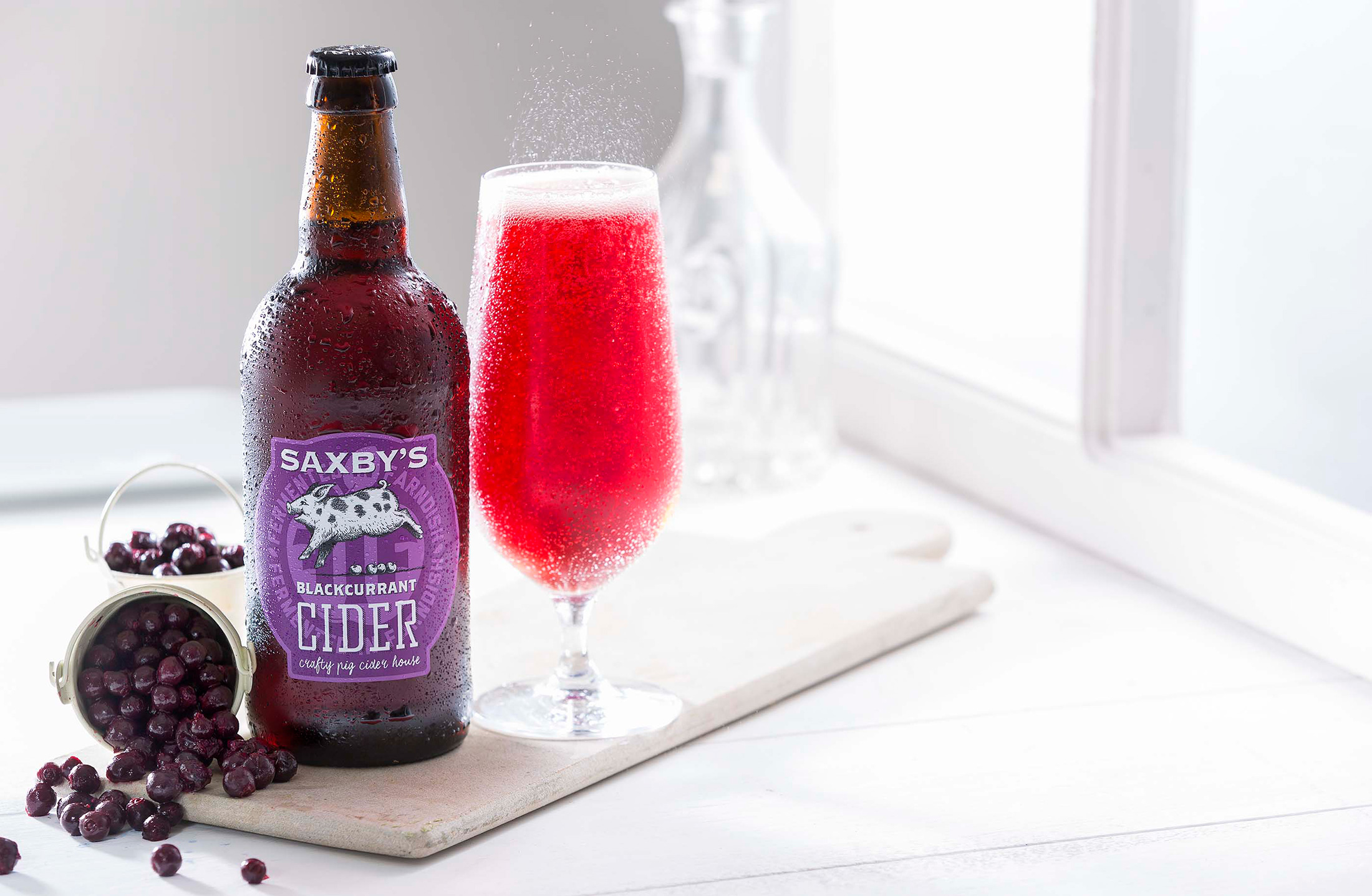 """""""Glorious blackcurrant red with lots of life in those shiny bubbles. Heady blackcurrant on the nose with a refreshing dryness to it. Well balanced sweetness with the tannic dryness making for a very pleasant mouthful with a long fruity finish. Appreciated the use of home grown blackcurrants and these are certainly the hero of the flavours, and well represented in a jolly decent cider."""" - 2019 Great Taste Judges' comments bout Saxby's Blackcurrant Cider"""