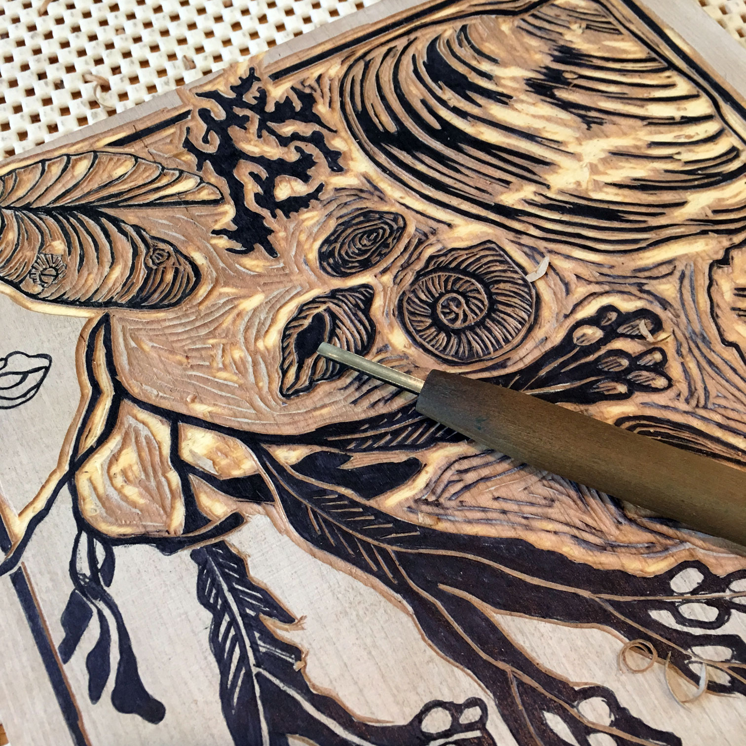 Cutting a one-color woodblock.