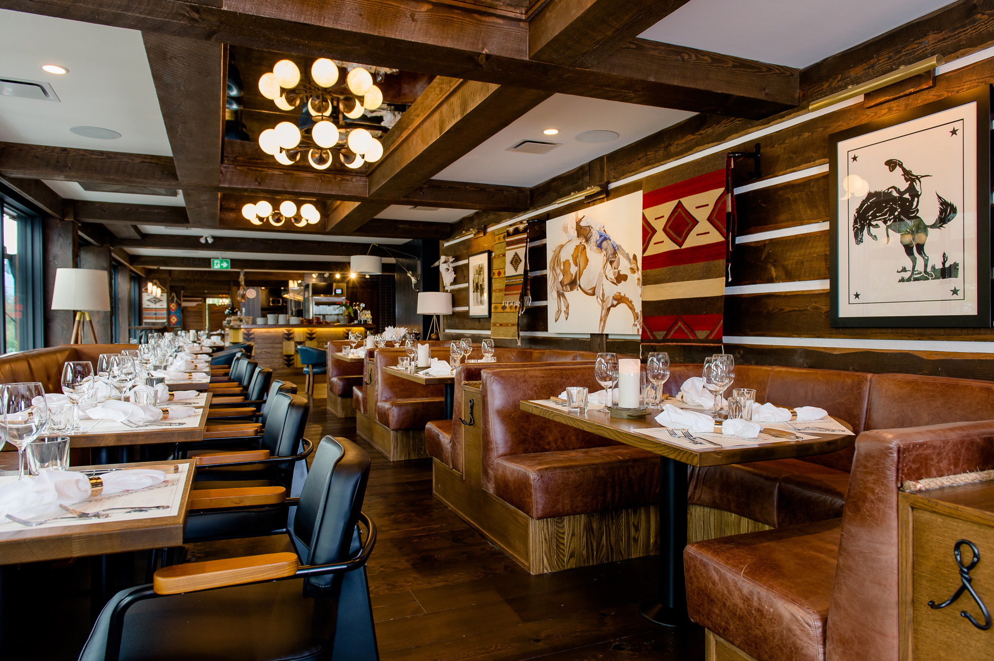 Saloon - 30 PEOPLEOur stylish ranch inspired saloon (main dining room) can seat up to 30 guests at a combination of booths and window front tables