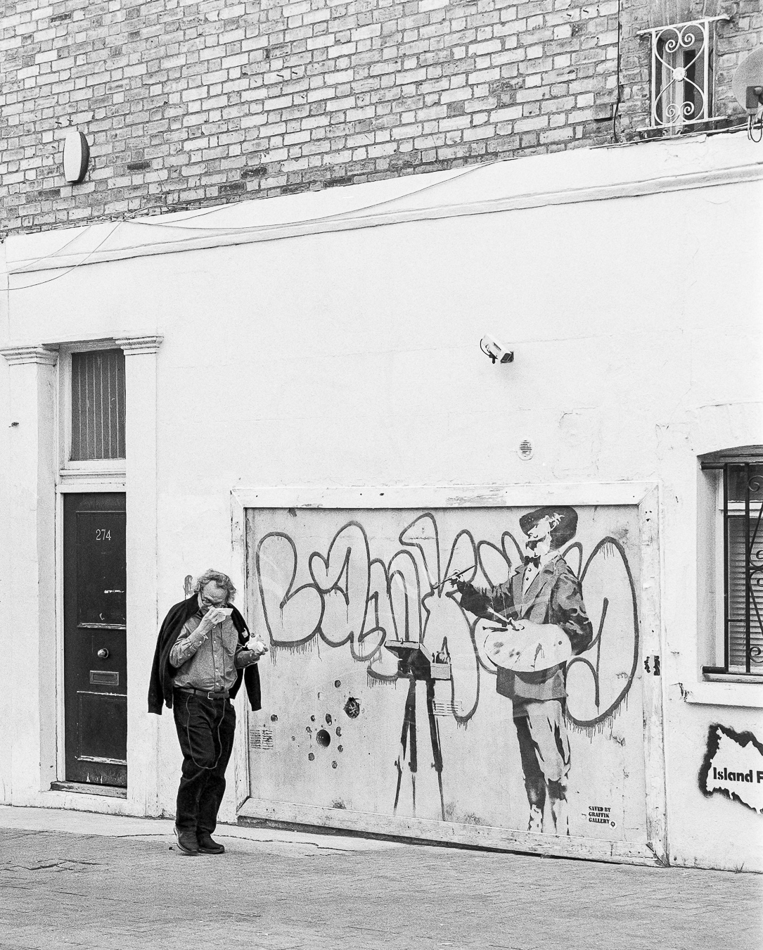 Banksy's 'Graffiti Painter', Cambridge Gardens, London - ARTVISIT