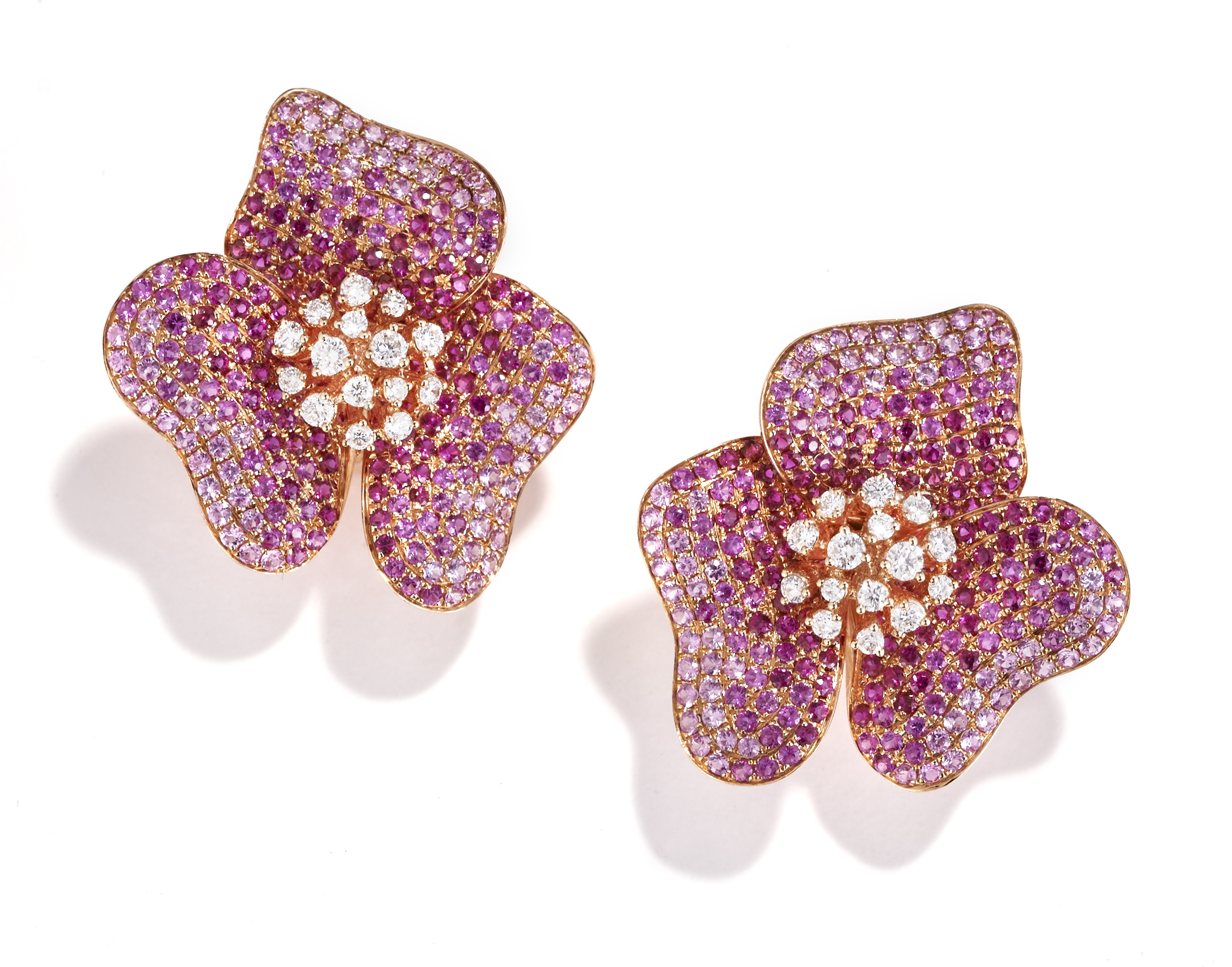 Delicate sapphire flowers with white diamond centers, in 18k rose gold