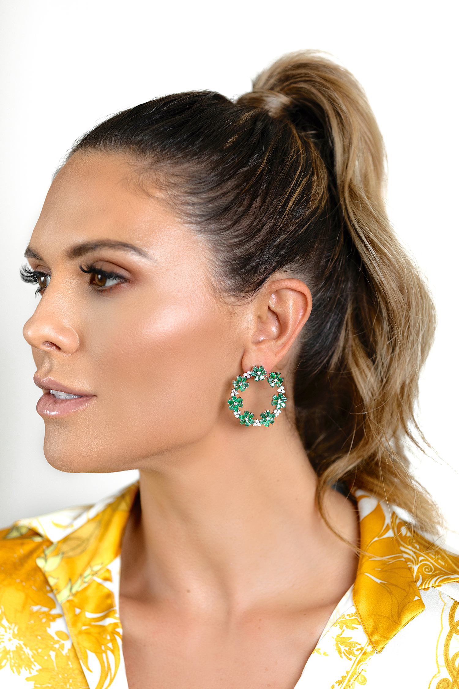 Bettina is gorgeous is diamond and emerald flower 18k gold hoops.