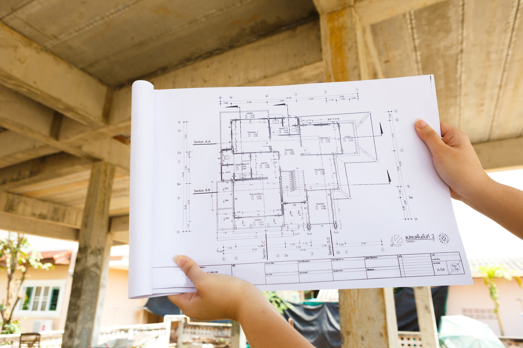 baeva architecture-drawings-in-hand-on-house-building-.JPG