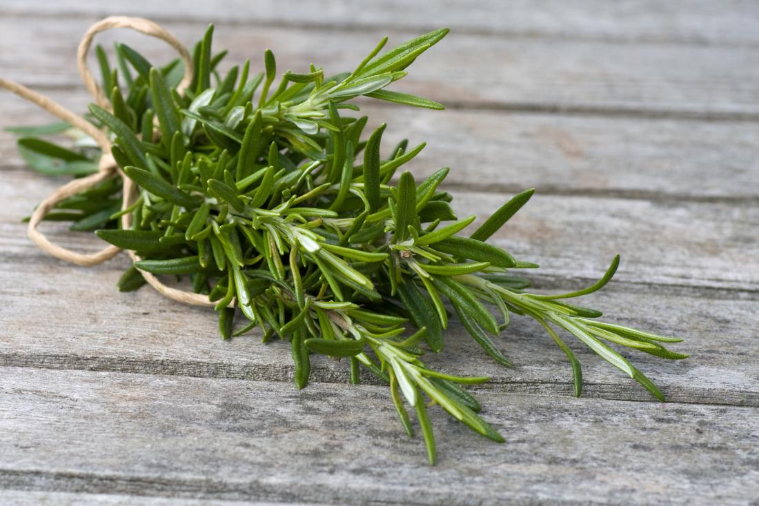 rosemary-leaves-bound-in-rope-on-wooden-table.jpg