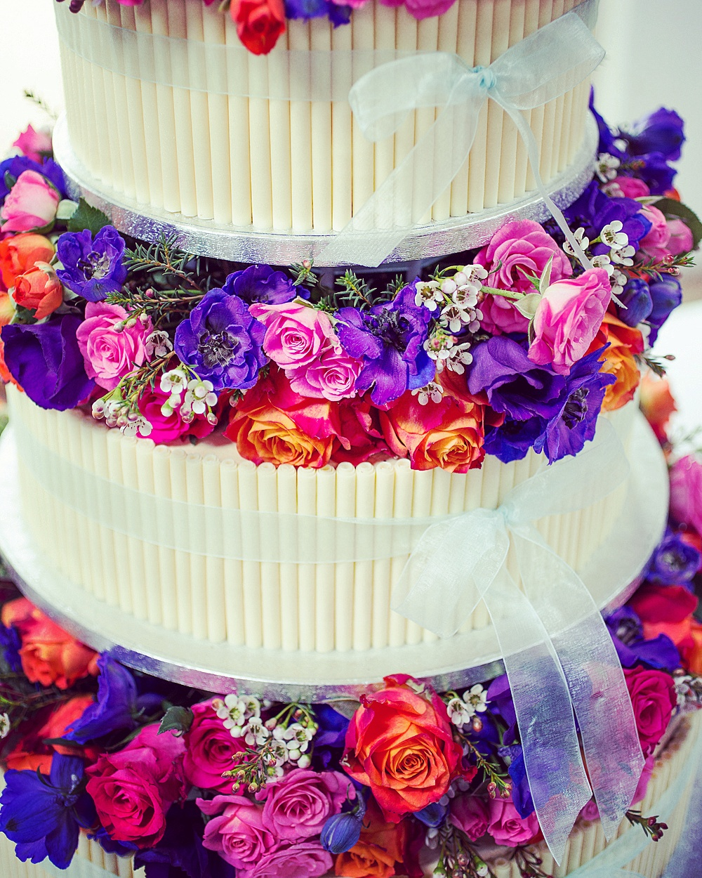 Cigarello and flowers wedding cake
