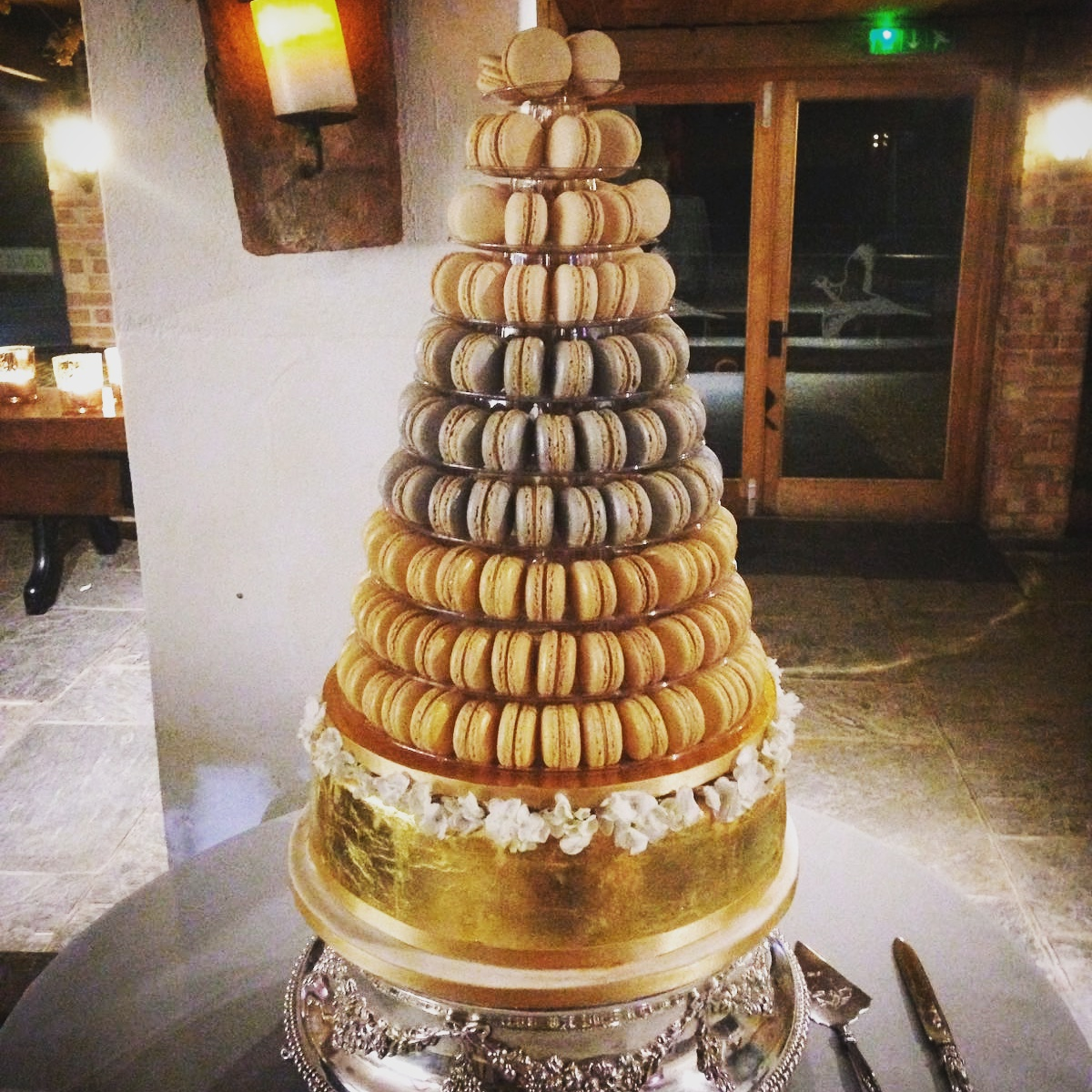 Macaron tower on gold painted cake