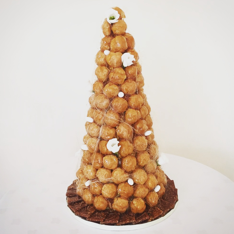 Croquembouche decorated with flowers and sugared almonds