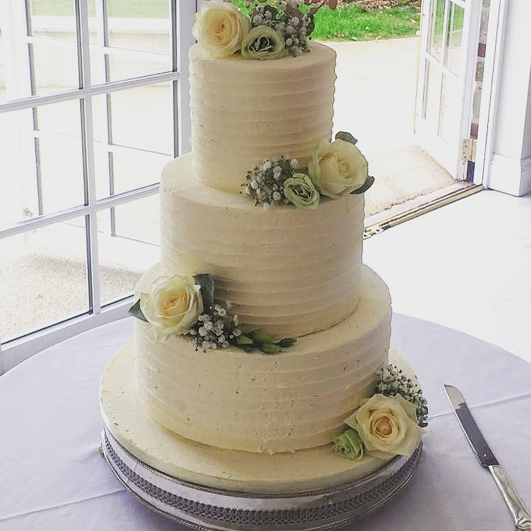 Buttercream spin wedding cake. Can come in a range of colours, including ombre effect.