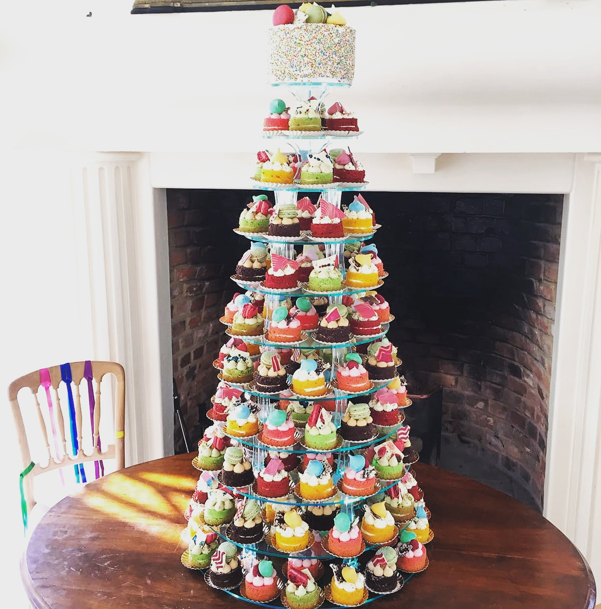 Colourful tea party tower - individual miniature filled and decorated cakes