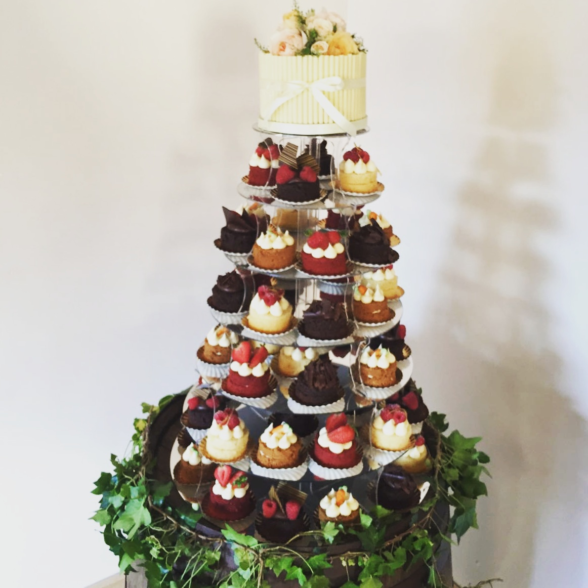 Traditional tea party tower with white cigarello top cake