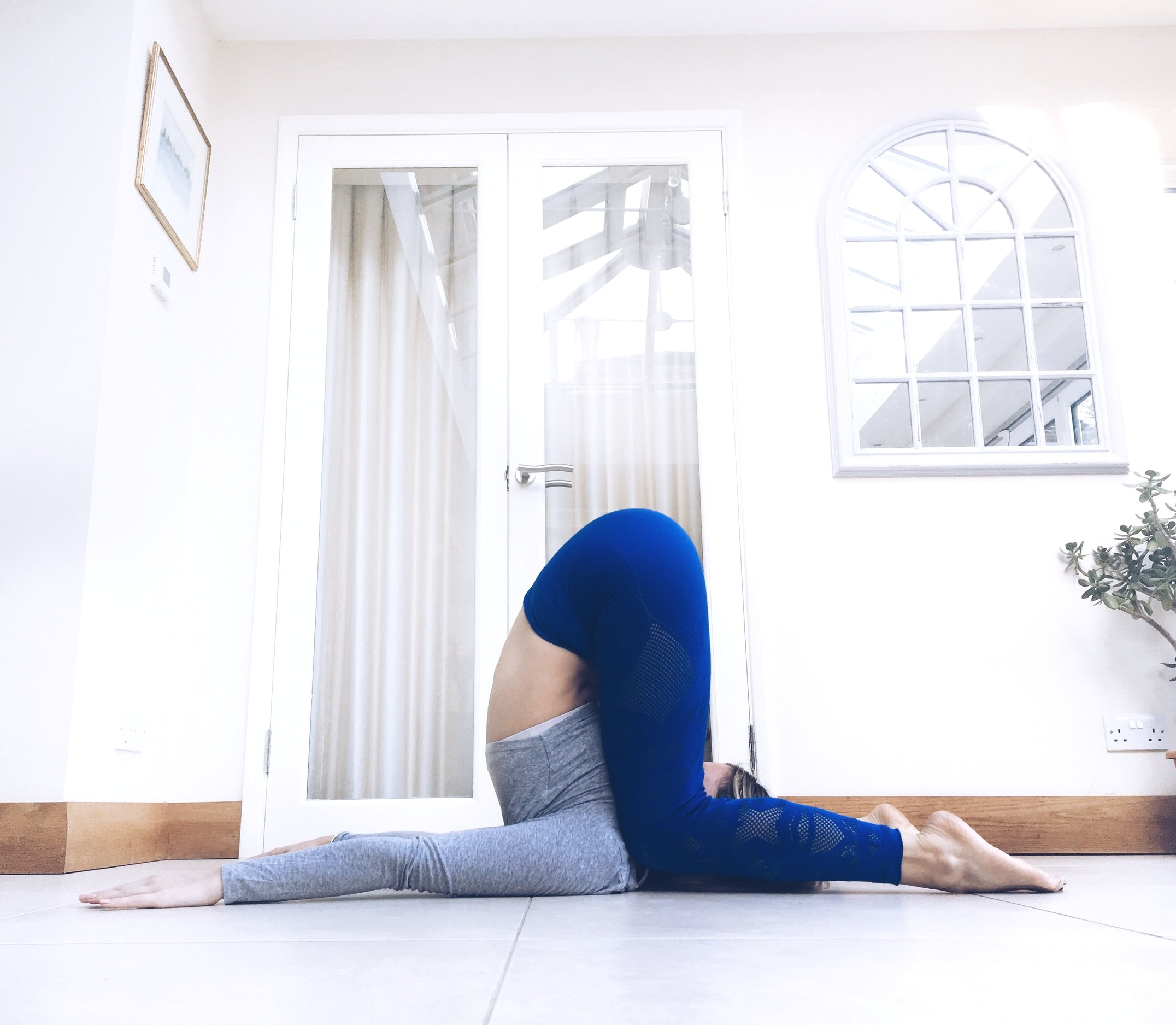 Karnapidasana. Knee to Ear Pose.
