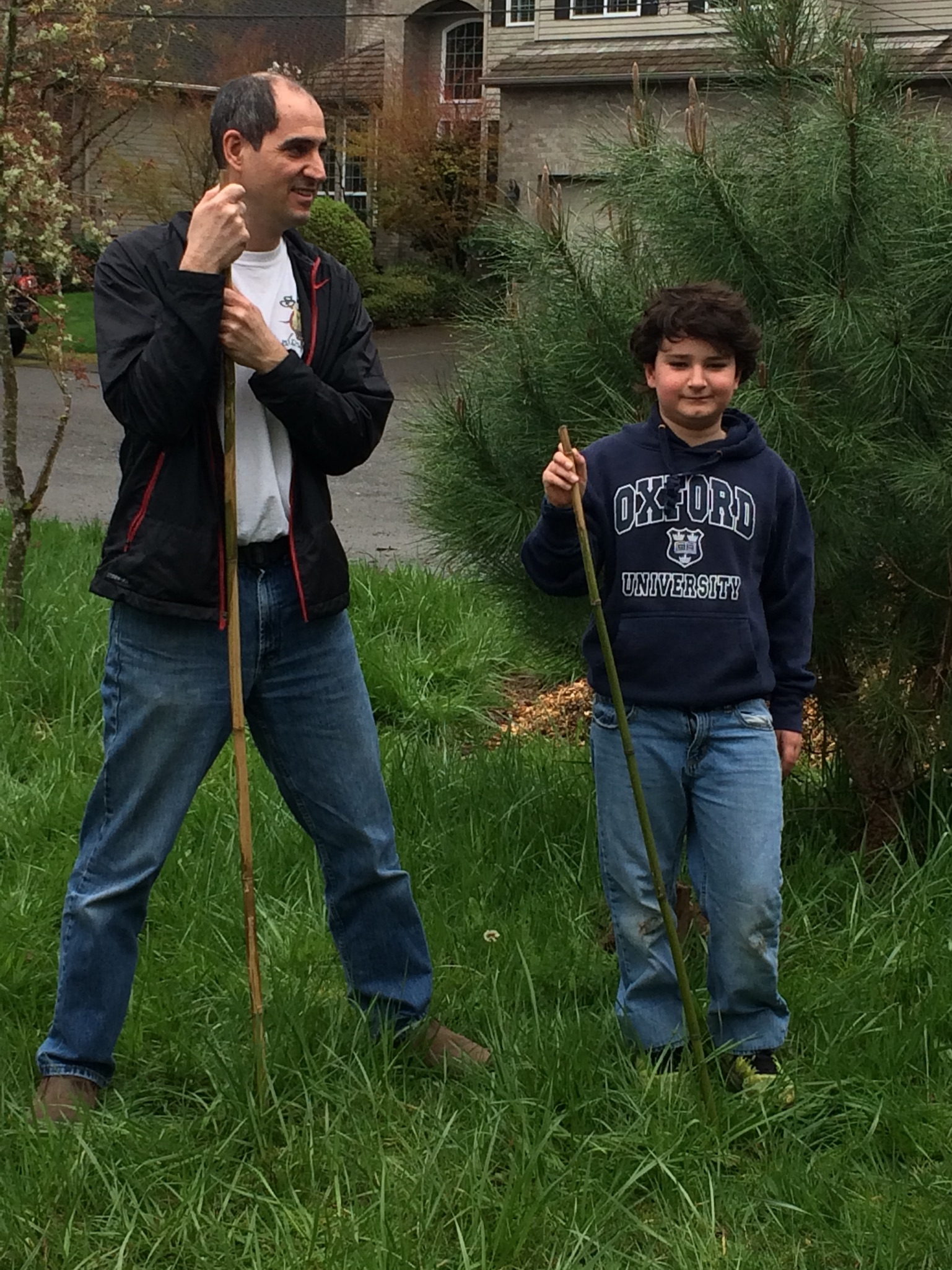 Nathan and Elio Spaccarelli prepare to plant trees.