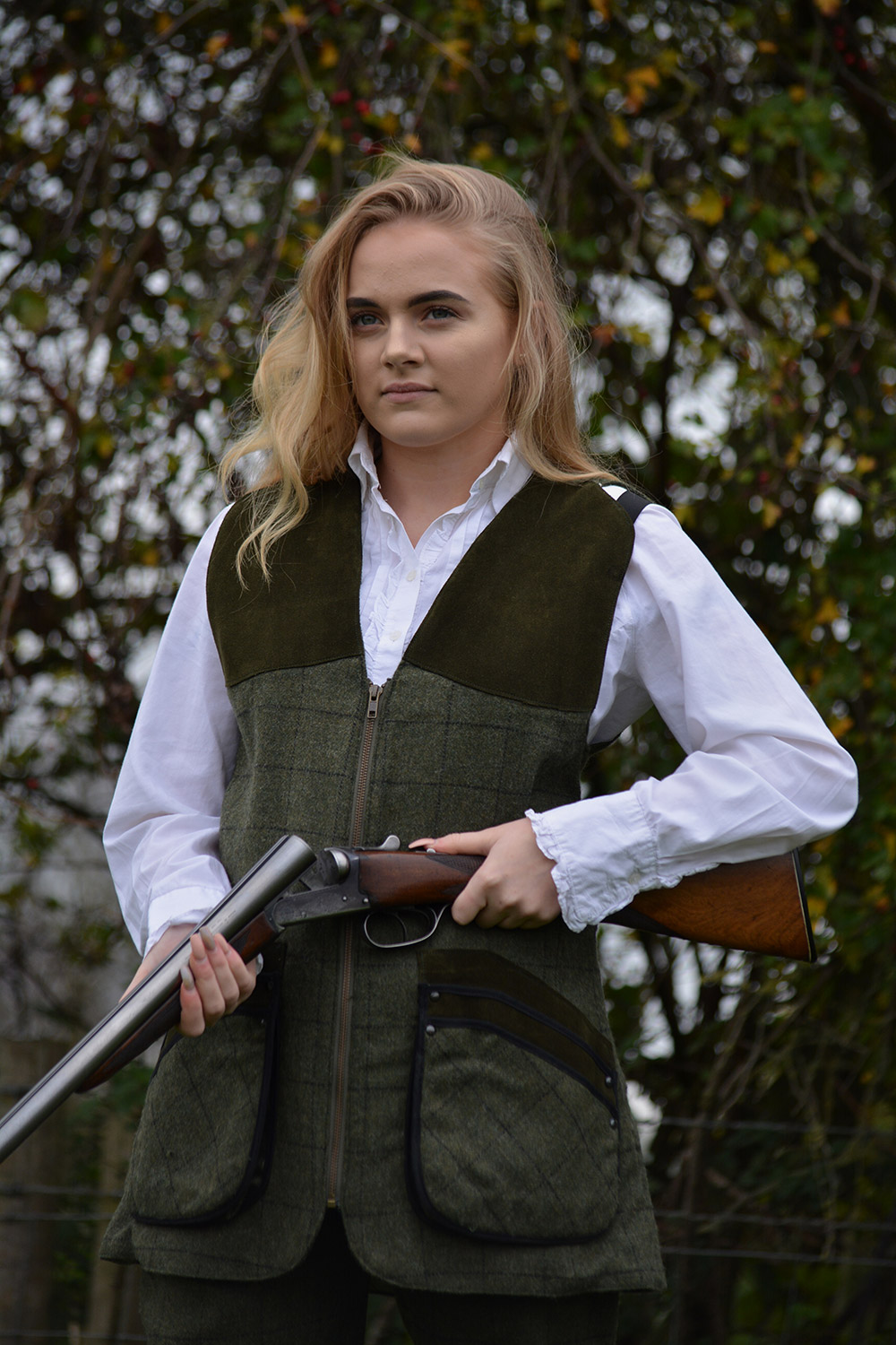 Emma-Brown-Tweed-Thistle-Shooting-Vest-Front-with-Gun.jpg
