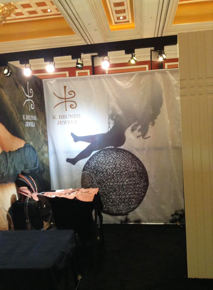 Paige and Ginger, Wrecking Ball, backdrop for K. Brunini Jewels Couture booth