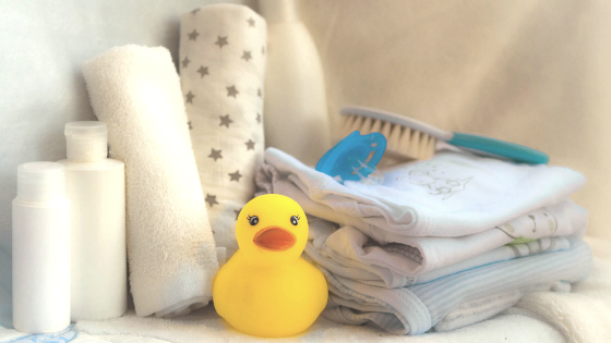 Set up your area with everything you'll need for during and after the bath including dry towels and a smallish receiving blanket.