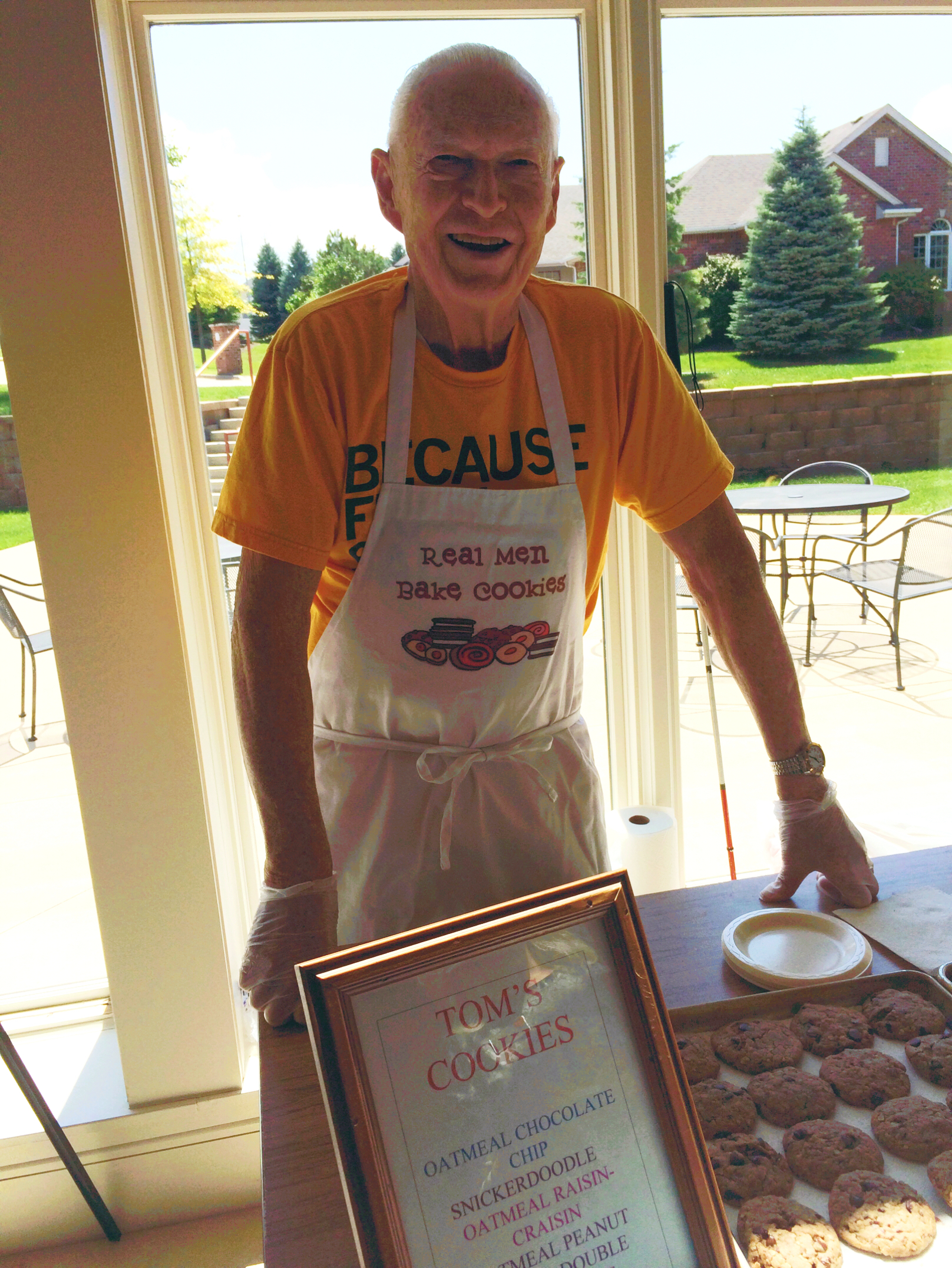 Tom with his special apron that his granddaughter gave him