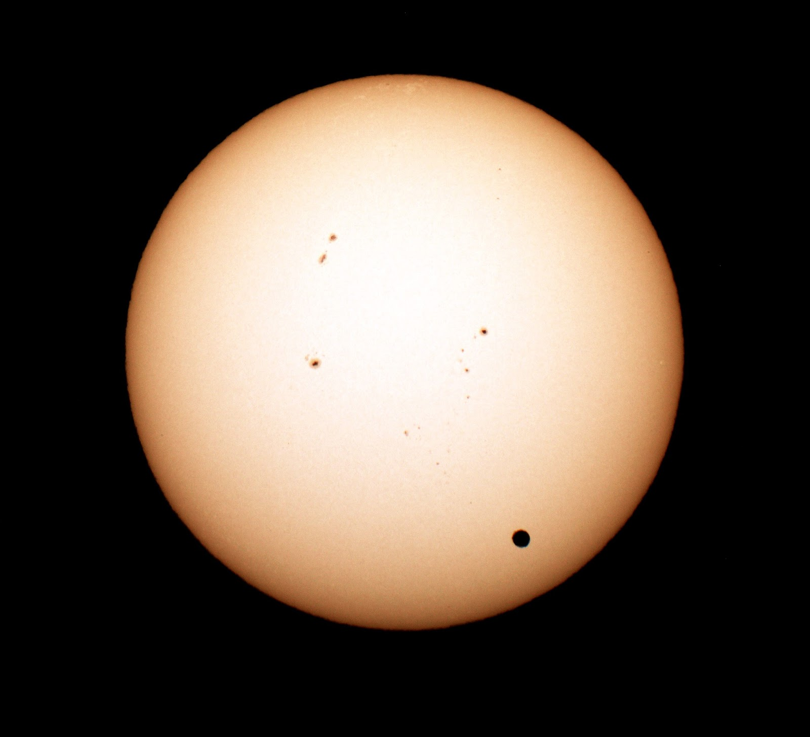 The transit of Venus of June 5, 2012. This photo, taken by my good friend Tom, shows our Sun. You can see sunspots across the face of the star, and in the lower right you see a black dot. That dot is Venus passing between Earth and the Sun... a transit. If we were to look at the light curve of this event before, during, and immediately after the transit, we would see the tell-tale dip in brightness as Venus passed across our field of view. I was fortunate enough to observe this event, as the next transit of Venus won't occur until my birthday in the year 2117! I'll be *#&$@ years old!