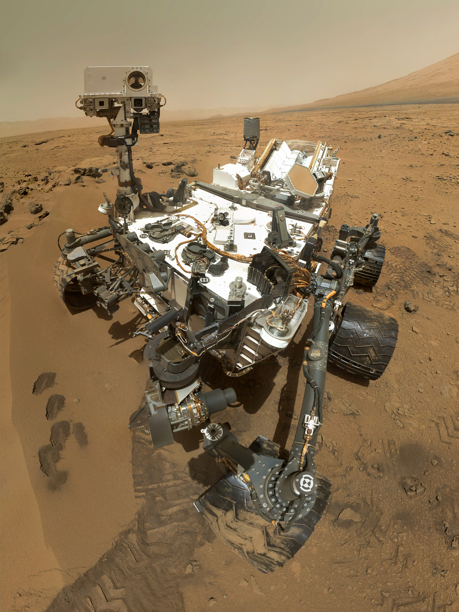 This self-portrait of one of Mars inhabitants; NASA's Curiosity Mars rover. The scene combines dozens of images taken during January 2015 by the MAHLI camera at the end of the rover's robotic arm.   Credits: NASA/JPL-Caltech/MSSS