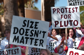Protestors angry over the discriminatory demotion of Pluto. Pssshh.