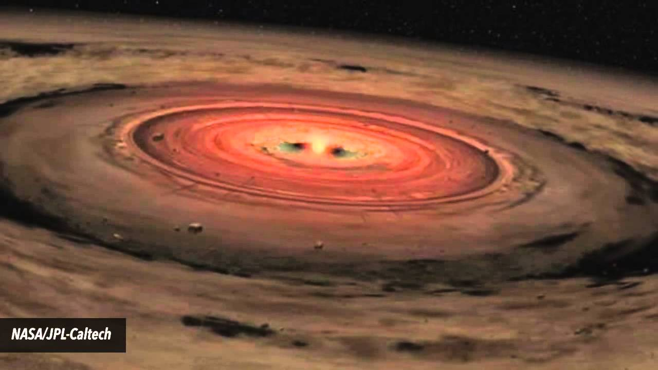 An artist's depiction of a young Sun having sparked to life in the midst of a gas-dominated protoplanetary disk.