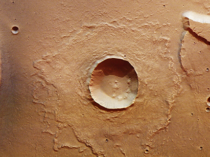This crater is located at the mouth of the Kasei Valles outflow channel. Considered to be evidence by some, that the Kasei Valles outflow channel was still wet when this impact occurred.