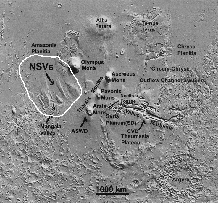 The Northwestern Valley Slopes (circled in white), if proven to be water-cut flood channels, would be the largest in the solar system.