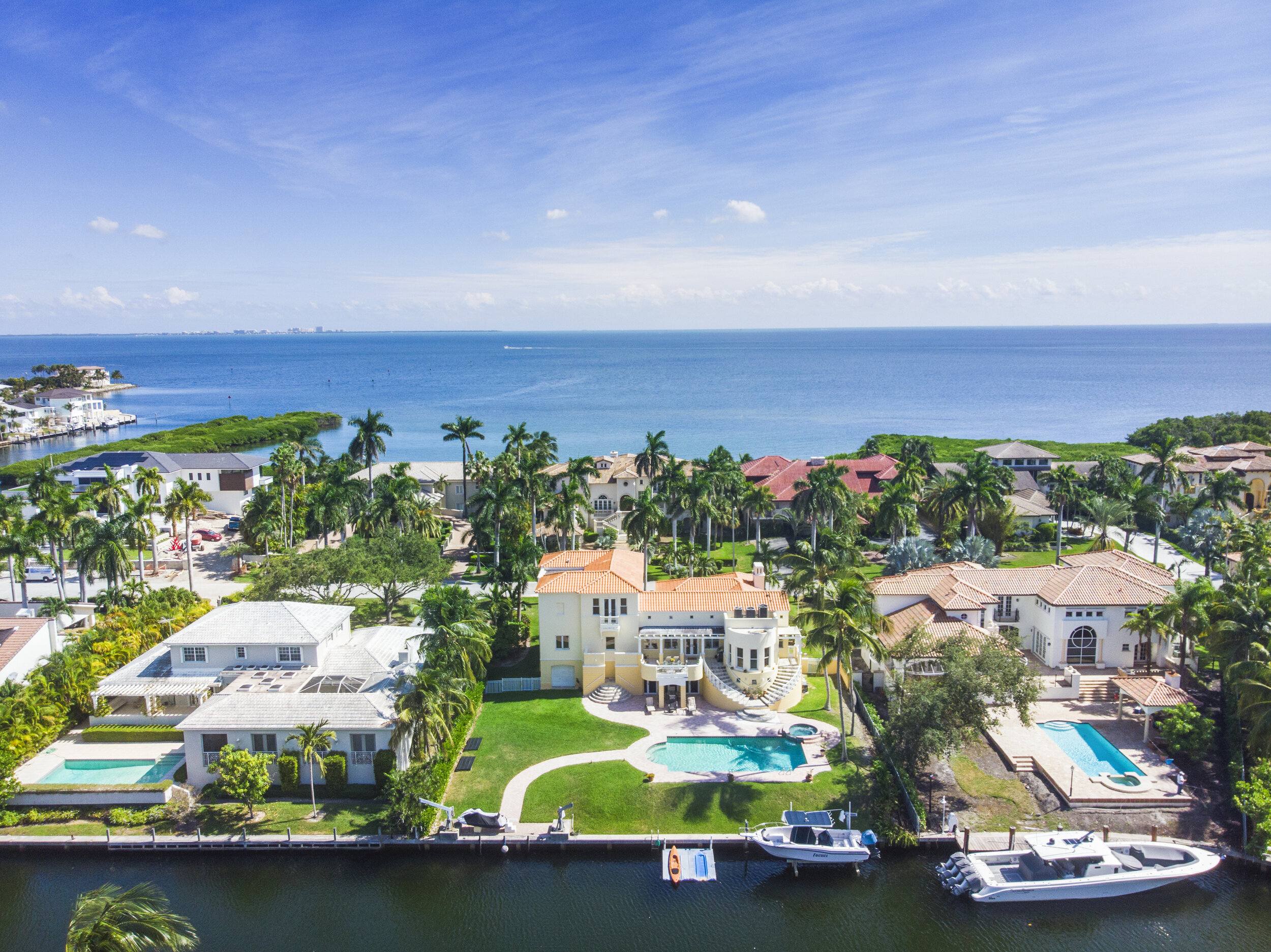 13040 Mar Street - On prestigious Mar Street in gated Gables by the Sea you will find this contemporary masterpiece with 110' of seawall and no bridges to Biscayne Bay. Davits, boat lift and floating dock are a boater's dream come true. The large eat-in kitchen provides beautiful views to the pool and wide canal. Sit on the back patio and enjoy Miami's beautiful sunsets. The spectacular, private master suite on the 3rd level includes generous his and her walk-in closets, sitting area and luxurious master bathroom. On the ground level, you will find 2 garages and a completely enclosed basement. This is a very special home which will allow you to enjoy all that Miami coastal living has to offer.bea.citron@compass.com305.606.7993