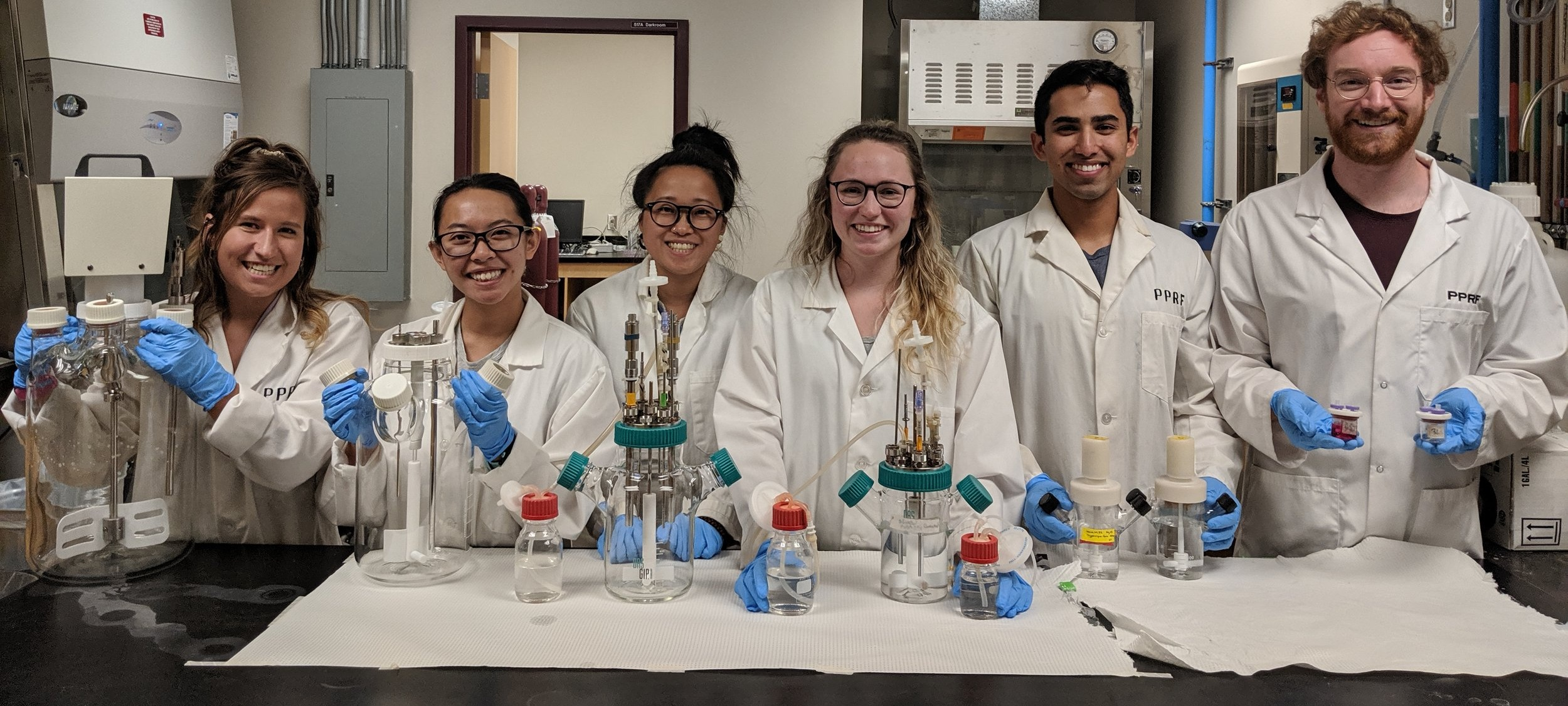 PPRF lab members pose for a photo with their bioreactors. From left: Breanna Borys, Tiffany Dang, Tania So, Alexis Pawluk, Sanchit Chopra, Brett Abraham. Brett and Tania are recent graduates of the Chemical Engineering program at UofC (BME Specialization), and Tiffany, Alexis, and Sanchit, are undergraduates in the program.