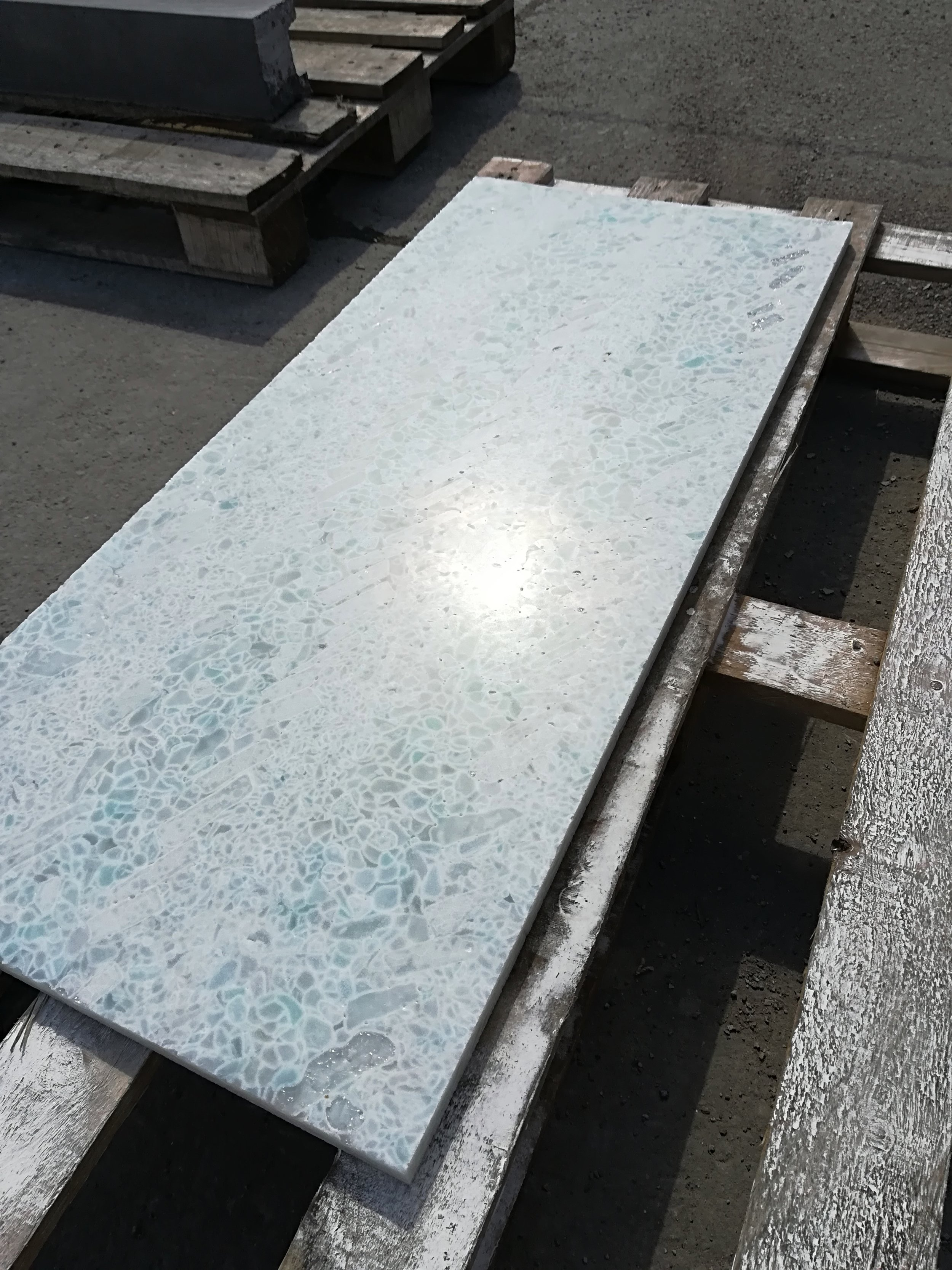 Recycled glass panels for reception desk design interation
