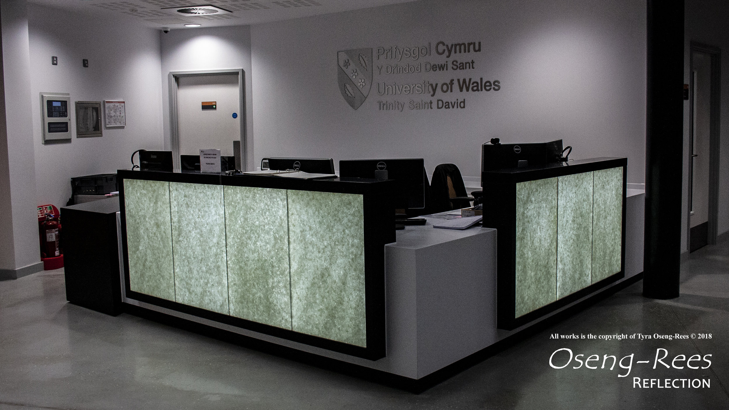 The reception desk is made from recycled glass designed in a bespoke maritime pattern positioned at the IQ Faculty building at University of Wales Trinity Saint David, Swansea SA1