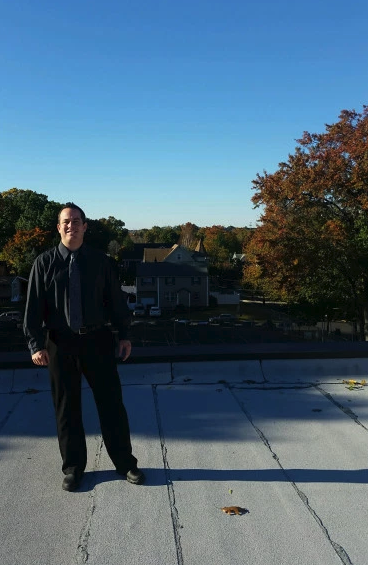 Principal Schweitzer on the roof of Union School
