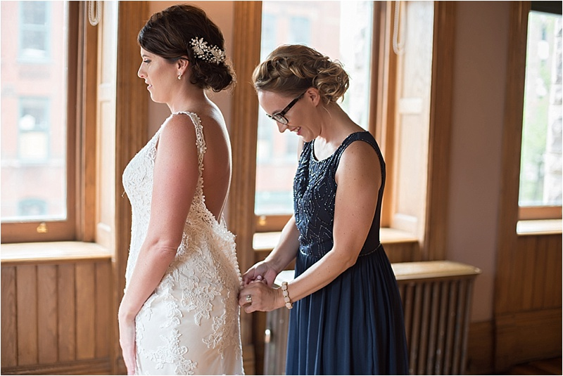 low back lace wedding dress and navy bridesmaid dress